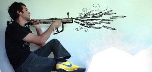 man firing pencils from a bazooka